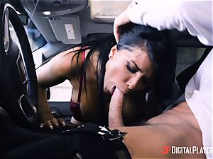 Romi Rain pounded in the back of the car