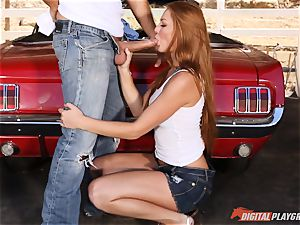 spectacular ginger-haired Farrah Flower drilled up against a car