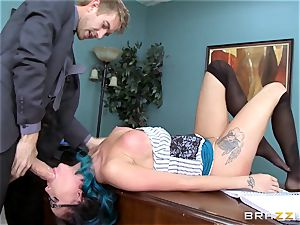 Raven Bay takes her bosses thick cock via the desk