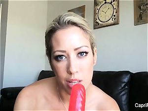 Capri plays with her gigantic faux-cock
