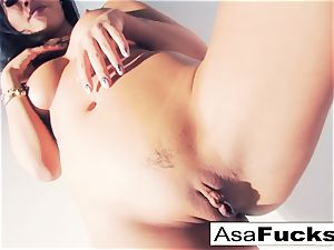 Asa Akira uses a faux hand to satisfy her vag