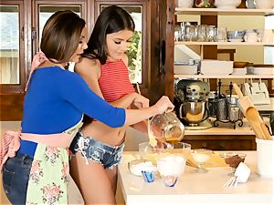 Kendra enthusiasm and Adria Rae girly-girl activity in the kitchen